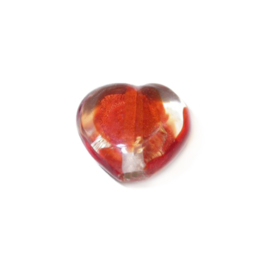 Transparent and red heart of glass