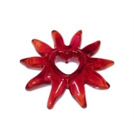 Rode zon van acryl met in het midden een hart