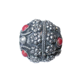 Metal bead, with red stones