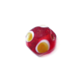 Red glass bead with yellow dots