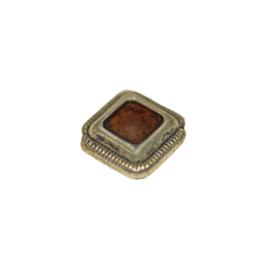 Metalen kraal met rood epoxy