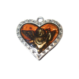 Metal heart with brown epoxy and an angel under it