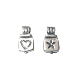 Silvercoloured charm made of metal