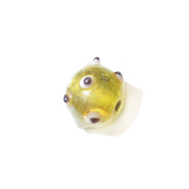 Gele glaskraal met zwart/witte uitsteeksels