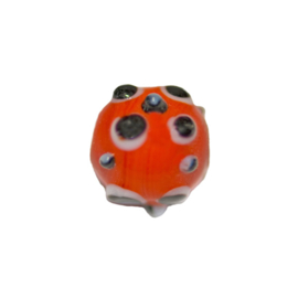 Round red glass bead with black and white dots