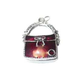 Bag charm made of metal with dark red