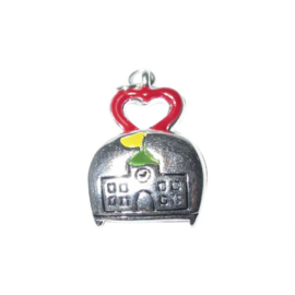 Schoolbag charm with a decoration of a school, made of metal