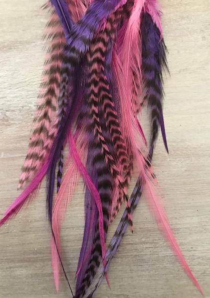 Maat S/M: 5 paars-roze feather extensions + 10 knijpringen /