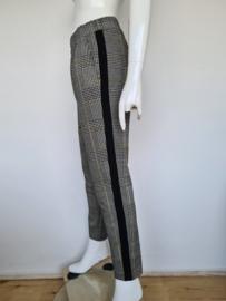 Madness pantalon. Mt. S. Zwart/wit/geel.