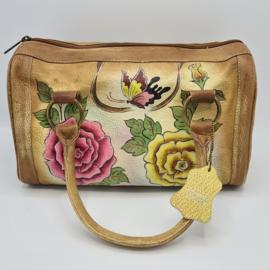 Leren vintage handtas met rozenprint.
