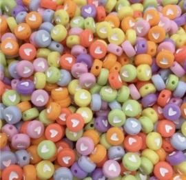 Fluor multi kleur hartjes 7 mm 50 stuks