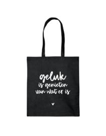 Zwarte katoenen tas met tekst 'Geluk is genieten van wat er is'
