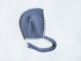 Knitted blue and beige bonnet