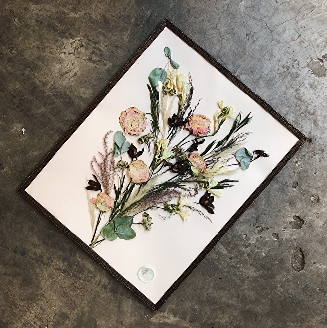 Dried wedding bouquet in frame