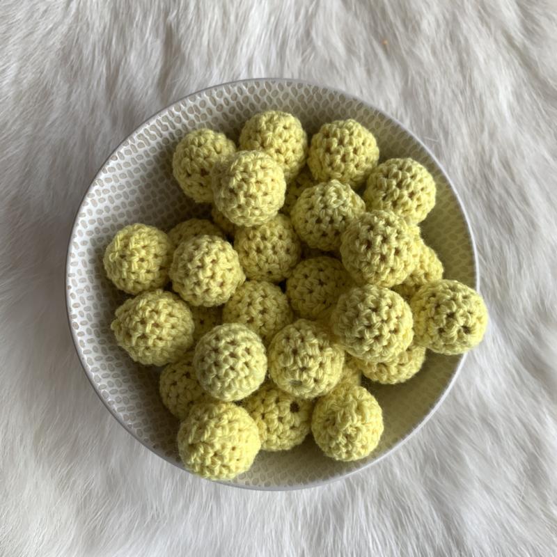 Gehaakte kraal 16mm - baby geel