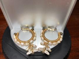 oorbellen creolen goud  met parel en vlinder