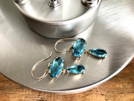 oorbellen lang goud kristal blauw