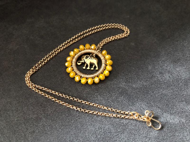 collier goud met medaillon geel facet met olifant