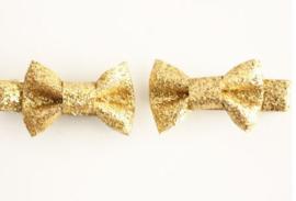 Strikje op clip 4cm goud glitter