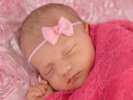 Haarband met klein strikje roze