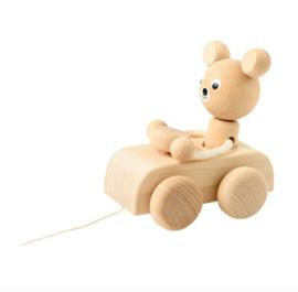 WOODEN BEAR IN CAR