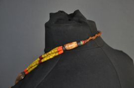Naga necklace with a half shell and yellow glass beads