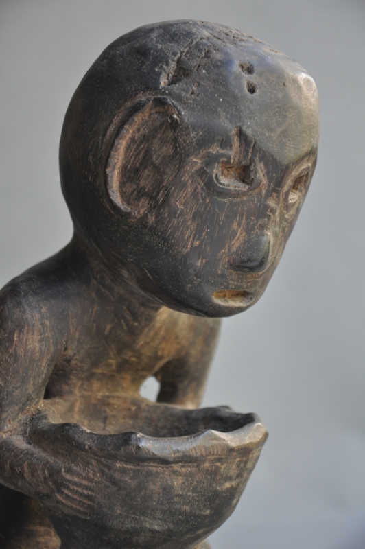 Ancient tribal TINAGKU BULUL statue with bowl, approx. 100 years old