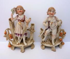 Pair of antique German bisque porcelain figural double spill vases