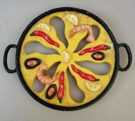 Vintage gietijzeren onderzetter voor paella pan