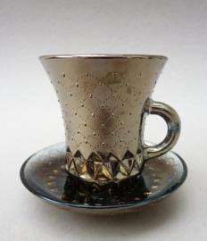 Carnival glass koperkleurige kop en schotel