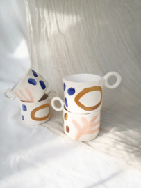 Set of white mugs