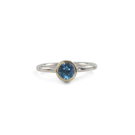 Silver ring with topaz in yellow gold setting