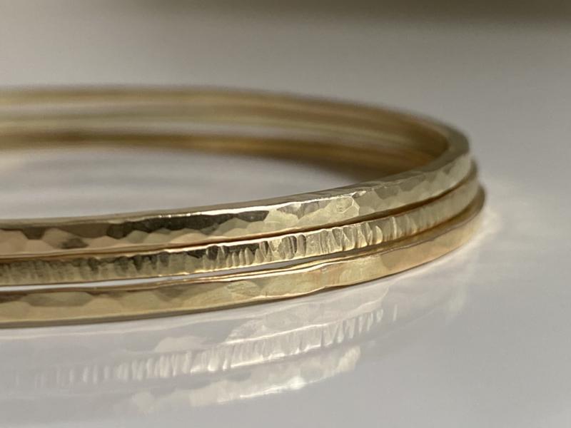 Set van drie 14krt gouden armbanden