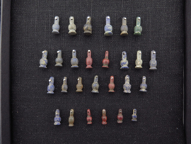 Collection of 27 Egyptian crystal poppy bead amulets