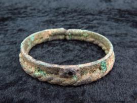 Ancient Bronze age bronze bracelet with garnet stone decoration