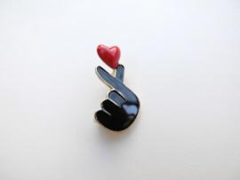 Broche Koreaans hart symbool.