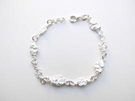 Zilveren piet-piet/mattenklopper bracelet. (dun)