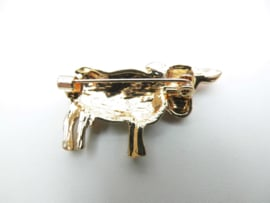 Broche koe wit.