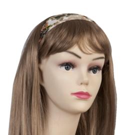 Mooie witte haarband met groen/rode bloemen.