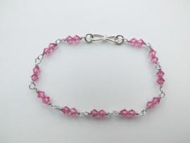 Zilveren roze kralen bracelet.