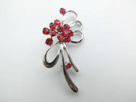Broche rode steentjes bloem.