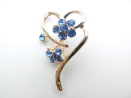 Broche blauwe steentjes hart.