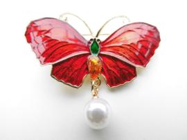 Broche rode vlinder met synth. parel.