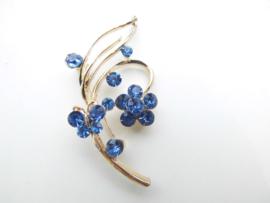Broche blauwe steentjes vlinder/bloem.