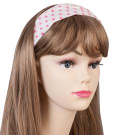 Mooie witte haarband met roze hartjes.