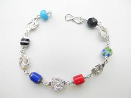 Zilveren mattenklopper/payet allakondre kralen bracelet.