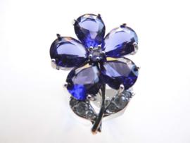 Broche blauwe bloem.