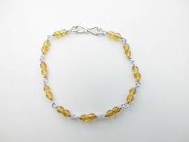Zilveren gember kleurige bracelet.