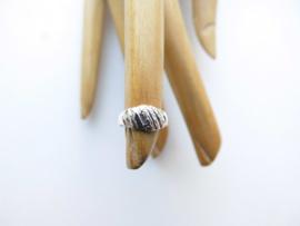 Zilveren baby ring.