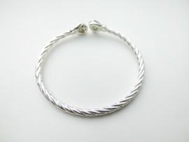 Zilveren vuist armband. (draai scheen)